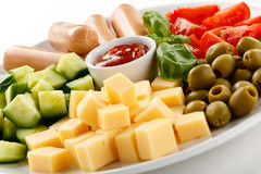Nutritious lunch -sausages and vegetable salad Royalty Free Stock Photos