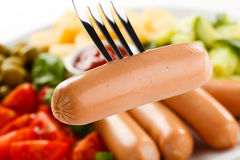 Nutritious lunch -sausages and vegetable salad Stock Photography