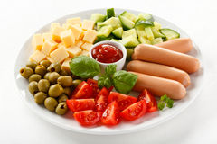 Nutritious lunch -sausages and vegetable salad Royalty Free Stock Photography