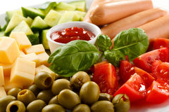 Nutritious lunch -sausages and vegetable salad Stock Photos