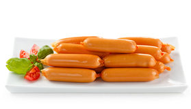 Nutritious lunch -sausages and vegetable salad Stock Images