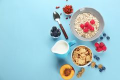 Nutritious oatmeal with berries. On color background Stock Photography