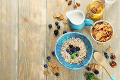 Nutritious oatmeal with berries. On table Stock Photos