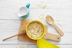 Nutritious oatmeal for breakfast. On wooden table Royalty Free Stock Image