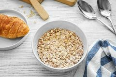 Nutritious oatmeal for breakfast. On wooden table Royalty Free Stock Photos