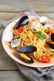 Nutritious pasta with meat mussels and squid on a plate Royalty Free Stock Photography