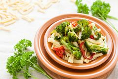 Nutritious pasta with pepper and broccoli on a plate closeup Stock Photography