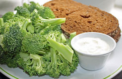 Nutritious Rye bread sandwich with a side of fresh Broccoli and a dipping sauce Stock Photos