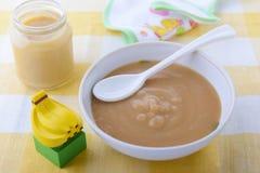 Nutrizione del bambino di pureefor della banana Fotografia Stock Libera da Diritti