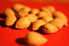 Nuts. Close-up of salted nuts on red background royalty free stock images