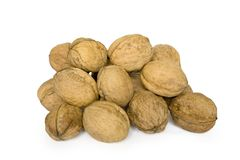 Nuts. Small group of brown nuts isolated on a white background Stock Photography