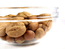 Nuts. Different nuts, walnuts, hazel nuts in a glass Royalty Free Stock Photos