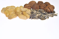 Nuts. Peanuts, sunflower seeds and nuts on white background isolated Royalty Free Stock Photos