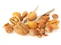 Nuts. Various sorts of nuts cracked open and whole with nutcracker Royalty Free Stock Photos