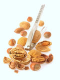 Nuts. Various sorts of nuts cracked and whole with nutcracker stock photography
