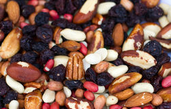 Nuts. Mixed nuts and raisans on a childrens plate Stock Photo