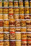 Nuts. A lot of jars with assorted canned nuts Stock Photos