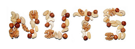 Nuts. Written with , cashew,almonds,wal Royalty Free Stock Photo