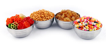 Nuts. Of a row in bowls - isolated Stock Photo