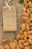 Nuts almond fruit and tag  label on wood Royalty Free Stock Photo