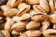 Nuts. Almond in shell. Almond in the bag; nuts on fabric background Royalty Free Stock Photography