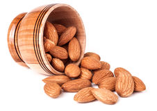 Nuts Almond in a wooden bowl isolated on white background Stock Photos