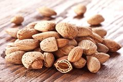 Nuts almonds. On a wooden table Stock Photos