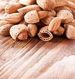 Nuts almonds. On a wooden table. Bottom space for text Stock Photos