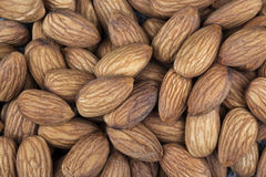 Nuts - Almonds. Almonds are the oval seed (kernel) of the almond tree. The fruit of the almond is a drupe, consisting of an outer hull and a hard shell with the Royalty Free Stock Images