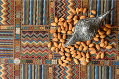 Nuts almonds on a carpet. Nuts almonds on a traditional Arabian carpet Stock Photos