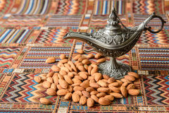 Nuts almonds on a carpet. Nuts almonds on a traditional Arabian carpet Stock Images