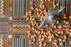 Nuts almonds on a carpet. Nuts almonds on a traditional Arabian carpet Royalty Free Stock Image