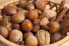 Nuts, almonds and cinnamon Royalty Free Stock Images