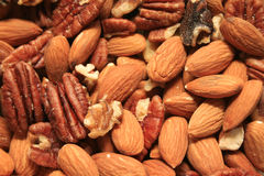 Nuts. Almonds pecans walnuts mixed in bowl Royalty Free Stock Photography