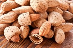Nuts almonds. On a wooden table Royalty Free Stock Photography