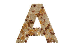 Nuts alphabet. Letters of the alphabet written with nuts Royalty Free Stock Image
