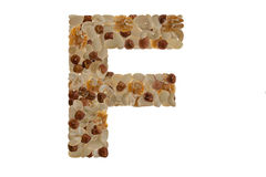 Nuts alphabet. Letters of the alphabet written with nuts Royalty Free Stock Photos