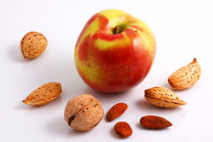 Nuts & Apple. Walnut, Almonds and Apple. Close-up Stock Photo