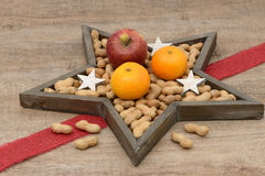 Nuts, apples and oranges Royalty Free Stock Photography