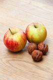 Nuts and apples Royalty Free Stock Photo