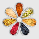 Nuts Assorted In Bowls. Nuts and dried fruit raw food assorted in bowls vector illustration Royalty Free Stock Photography