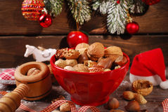 Nuts assortment in bowl on wooden table for christmas Stock Image