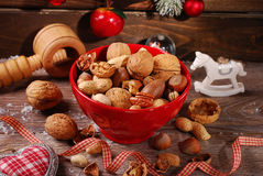 Nuts assortment in bowl on wooden table for christmas Stock Images