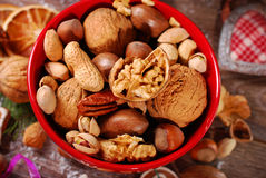 Nuts assortment in bowl on wooden table for christmas Stock Photo