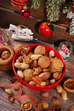 Nuts assortment in bowl on wooden table for christmas Stock Photography