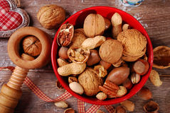 Nuts assortment in bowl on wooden table for christmas Royalty Free Stock Photo