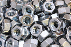 Metal Nuts background. A pile of metal nuts Royalty Free Stock Images