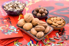Nuts in the Background of Red Couplet in Spring Festival royalty free stock photos