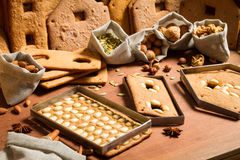 Nuts and baked gingerbread cottage Royalty Free Stock Images