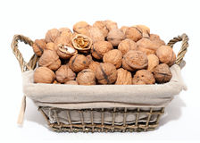 Nuts. Basket full of walnuts isolated on white background Stock Photo
